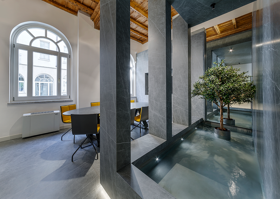 Neolith Zaha Stone with olive tree and pool as focal points at the showroom welcome area, Agora.