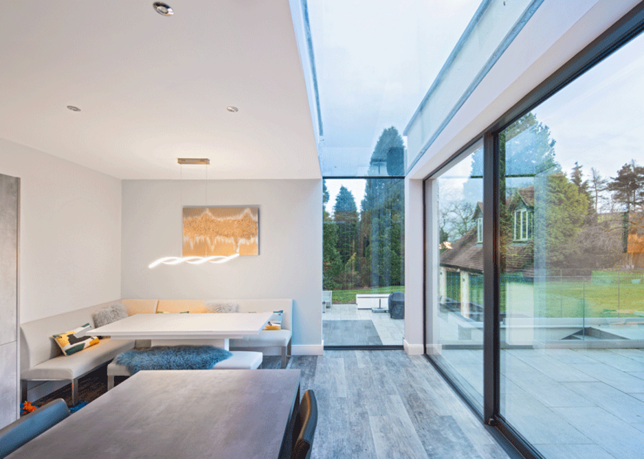 The Glazing Vision Eaves Flushglaze rooflight comprises two glazed sections installed in vertical and horizontal planes, joined with a silicone seal.