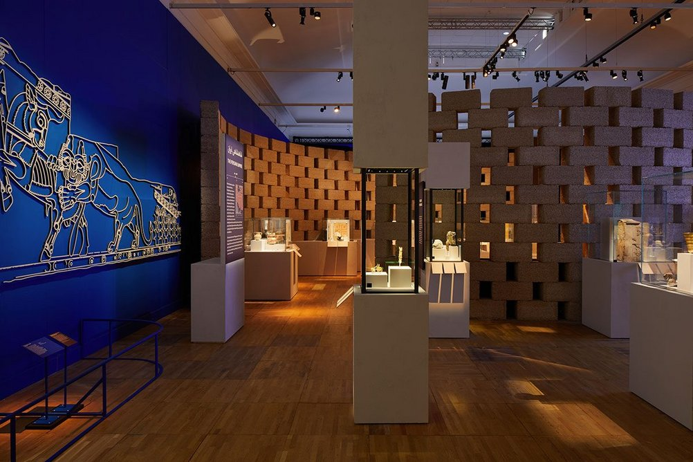 Installation view of Epic Iran, an exhibition designed by Gort Scott at the V&A, London. Vibrant colours are used to create distinct atmospheres in different sections of the exhibition.