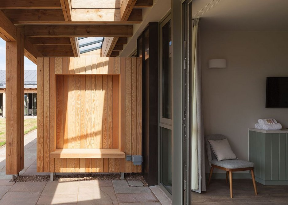 The loggia is constructed in Douglas fir and includes a single-glazed rooflight. Each partition includes an alcove seat with recessed lighting.