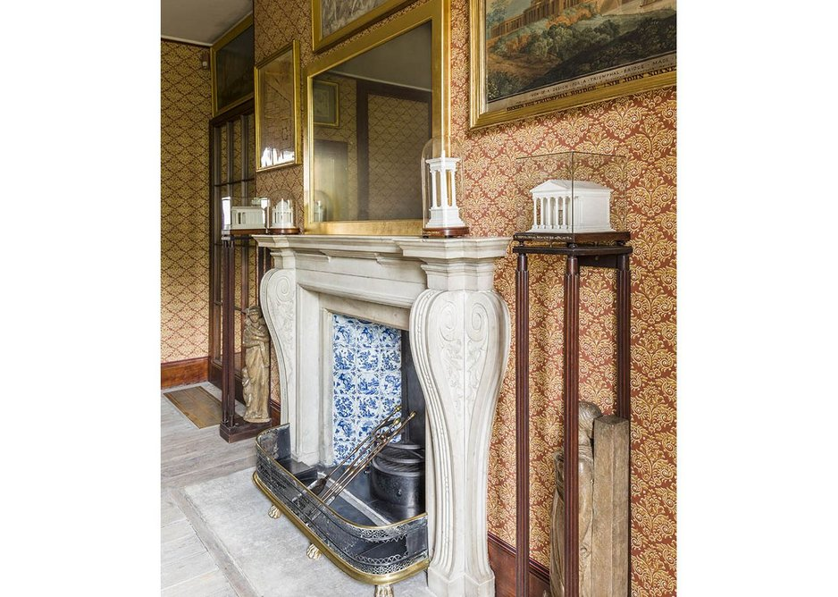 The chimney piece in the model room with Fouquet models on display.