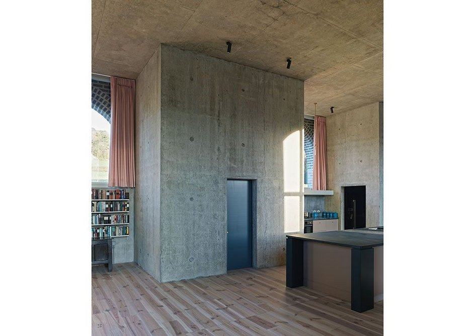 The concrete towers rising through the main space contain lesser spaces – here there is a small study.