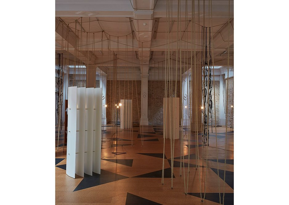Leonor Antunes: The Frisson of the Togetherness at the Whitechapel Gallery. Ropes stretch full height and across the ceiling.