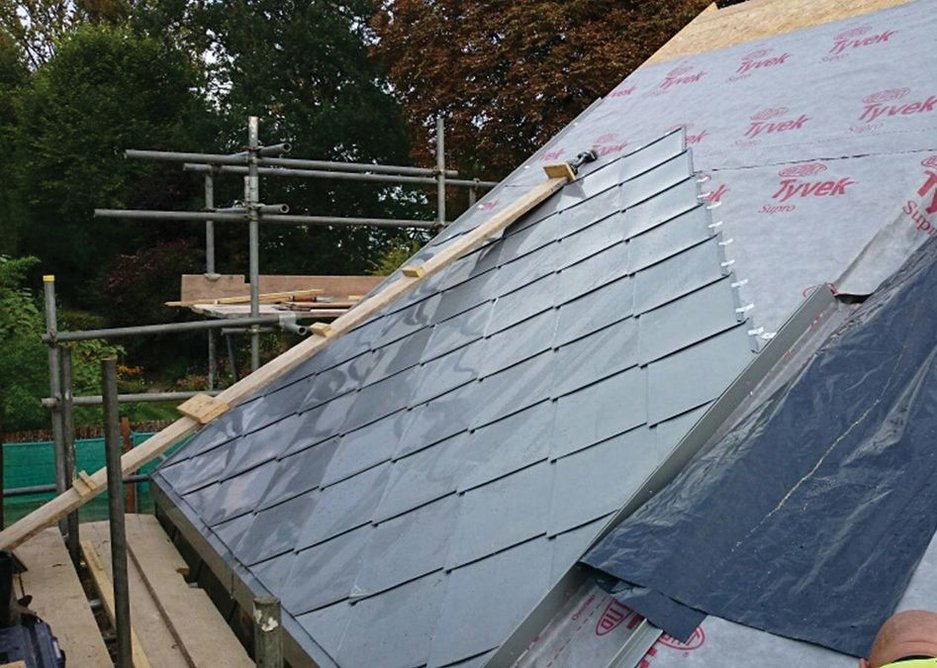 Bespoke NEDZink shingles being fixed to the plywood substrate