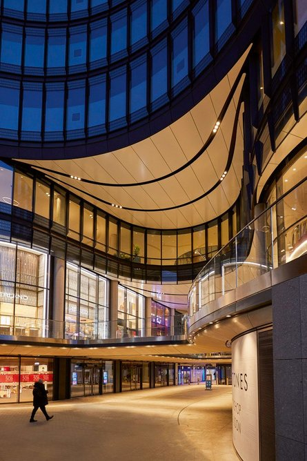 Two-storey retail units within the enlarged Octagon Mall are accessed from ground-floor-level decks and bridges.
