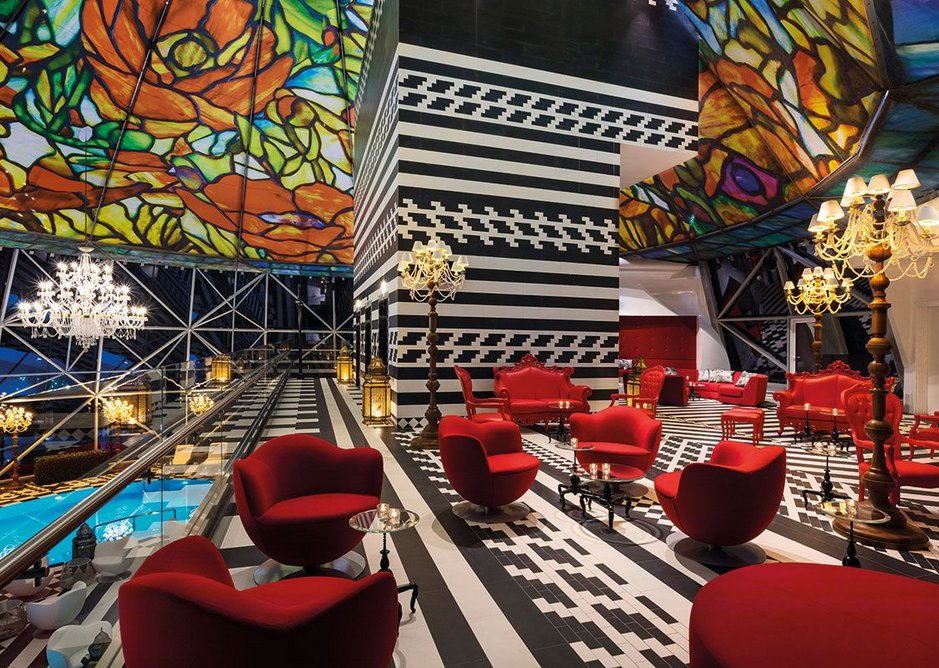 The stained glass dome of the pool area is augmented by a bar in a riot of colours