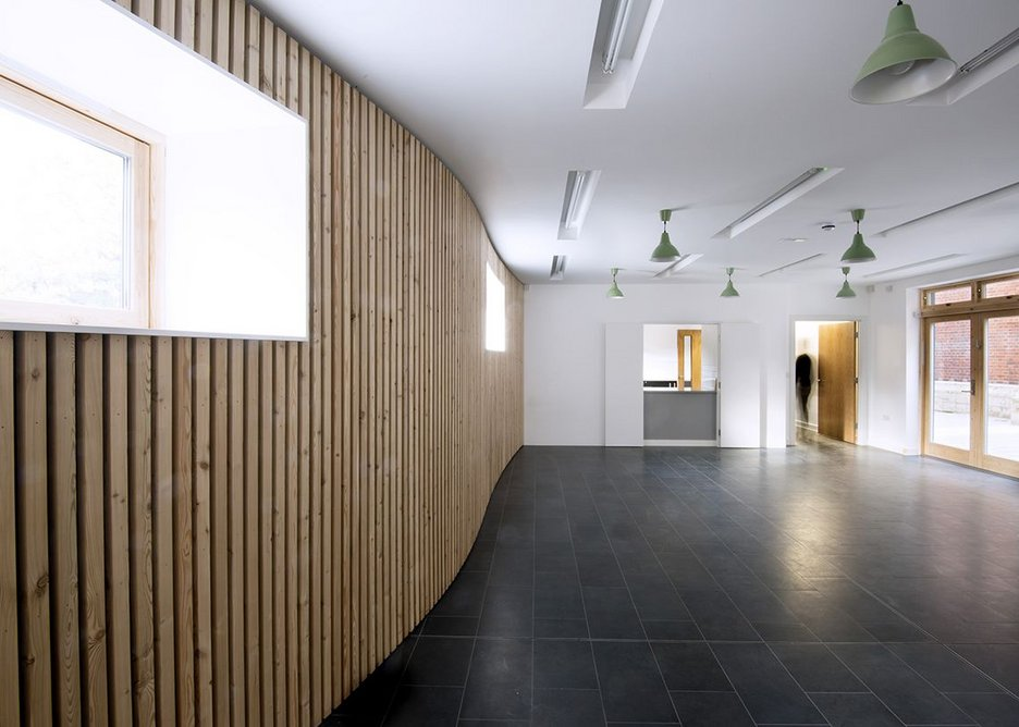 A modest community space, with kitchen, leading onto the courtyard.