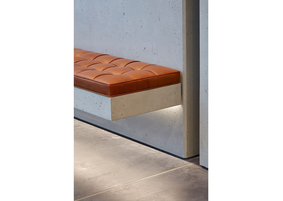 A close up of the concrete and brass floor from Lazenby at Bennetts Associates' One Bedford Avenue.