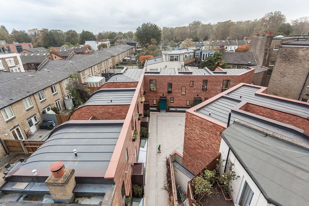 Penrose Mews occupies a triangular infill plot in Fulham.