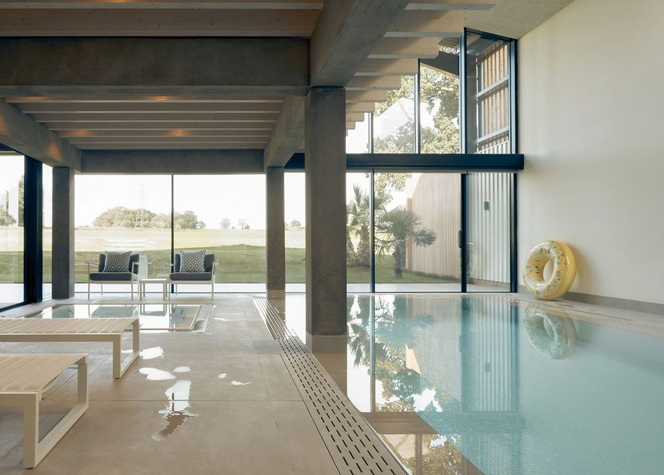 The swimming pool occupies as much of the ground floor as the living area.