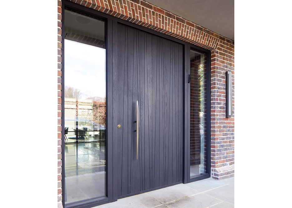 Urban Front Milano V e80 pivot doorset in Oak with an ebony stain, matching sidelights with clear glass and Option BZ5 handle.