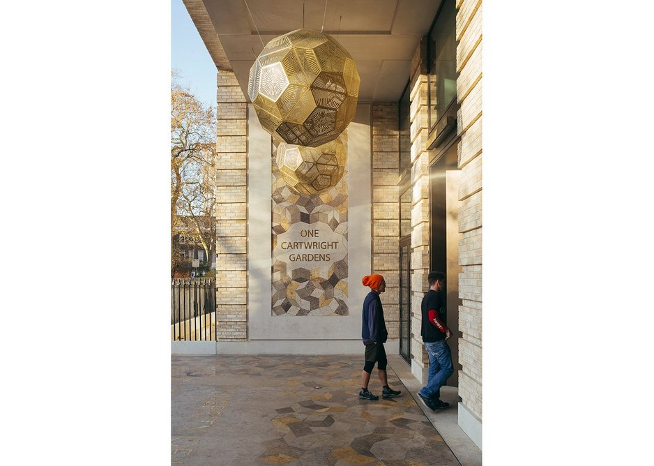 Entrance mosaic and lamps by Tom Dixon.