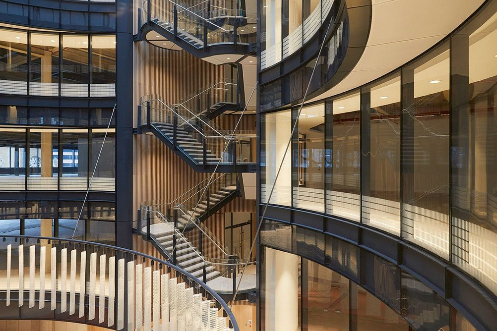 To aid orientation, open stairs create visual connections between lift lobbies and the tapering atrium.