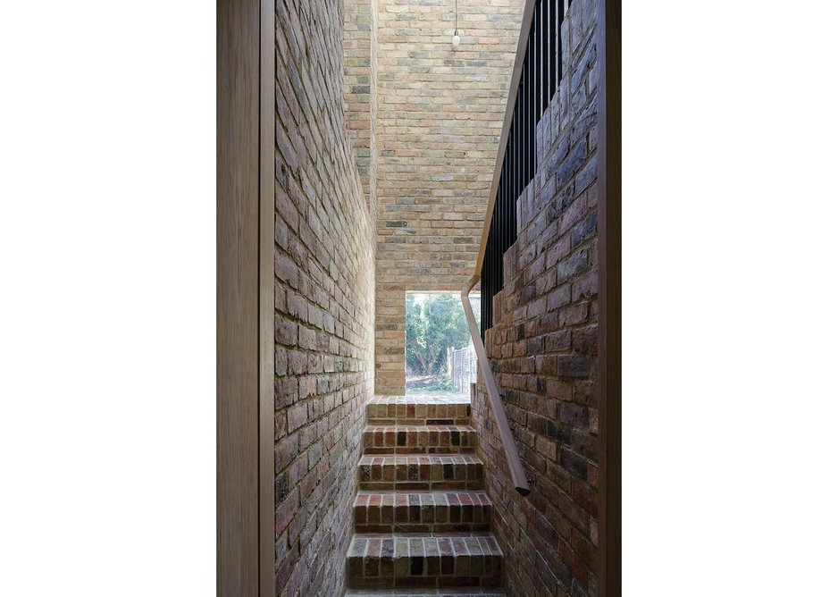 The brick back stair snatched views of the garden.