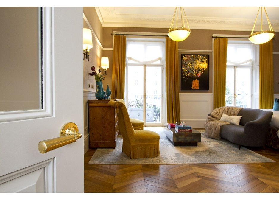 Polished brass door levers by Samuel Heath have a smooth classic design in keeping with the timeless elegance of the Leinster Square properties.