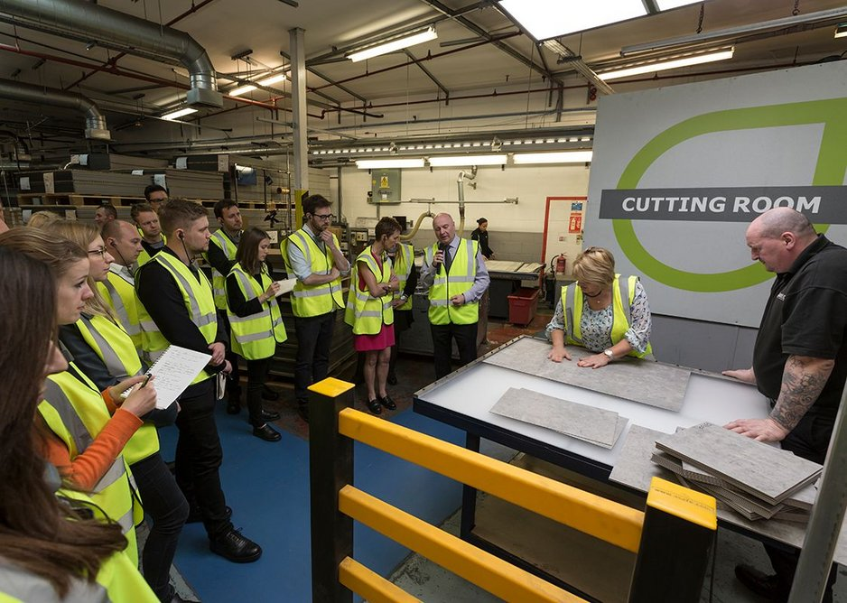 Competitors visiting the cutting room as part of a tour of Amtico's Coventry factory.