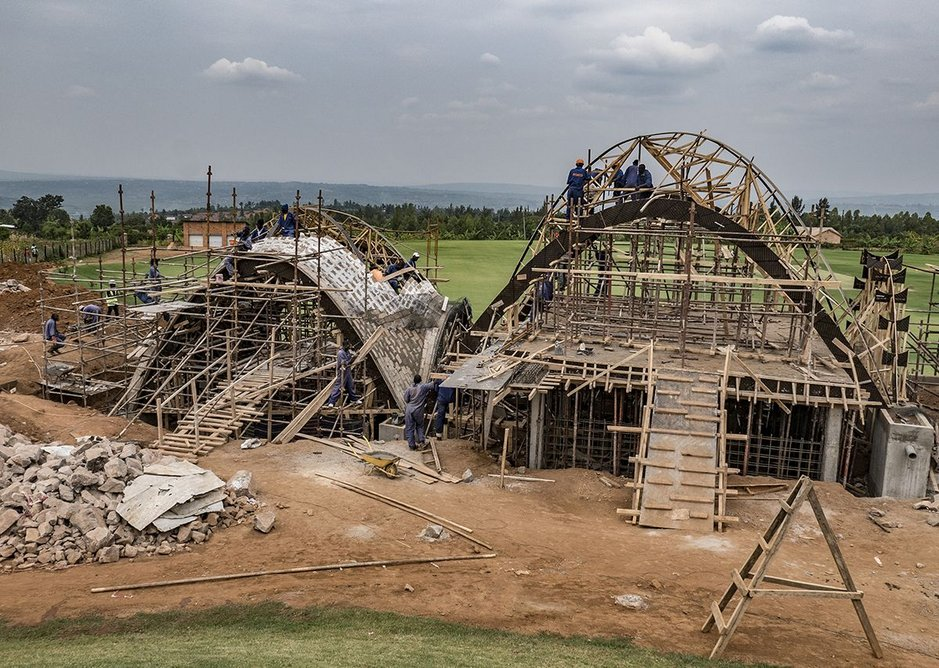 The arches under construction. Minimal timber structures act as guides.