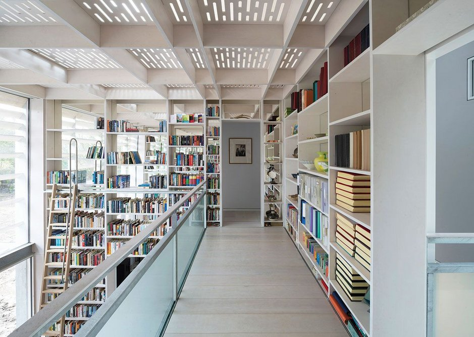 To access the upstairs bedrooms, you cross the library's dazzling mezzanine.
