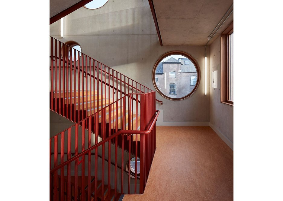 The architect's signature circular windows appear in the simply detailed staircases.