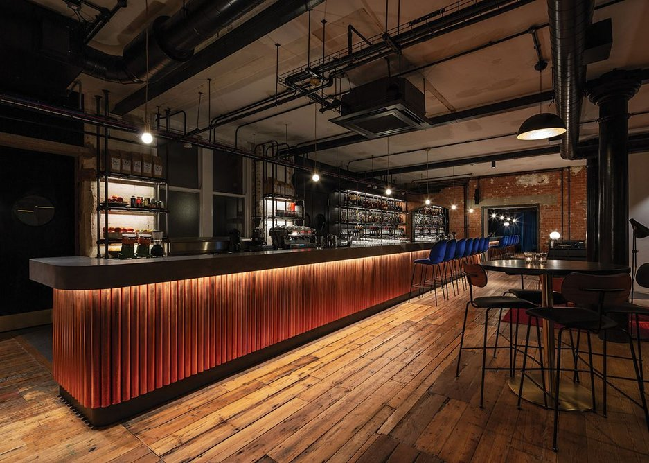 The bar on the ground floor is faced with bronzed scaffolding poles.