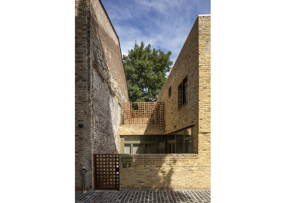 Entrance courtyard and terrace of first house: privacy with high quality joinery.
