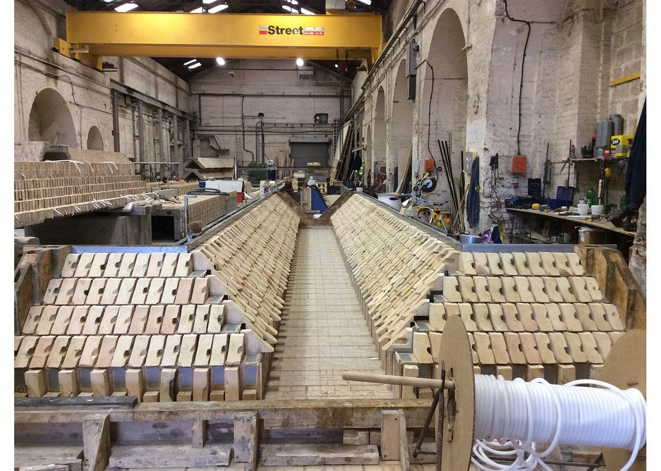 How they made it 2 - cut bricks being laid in precast formwork.