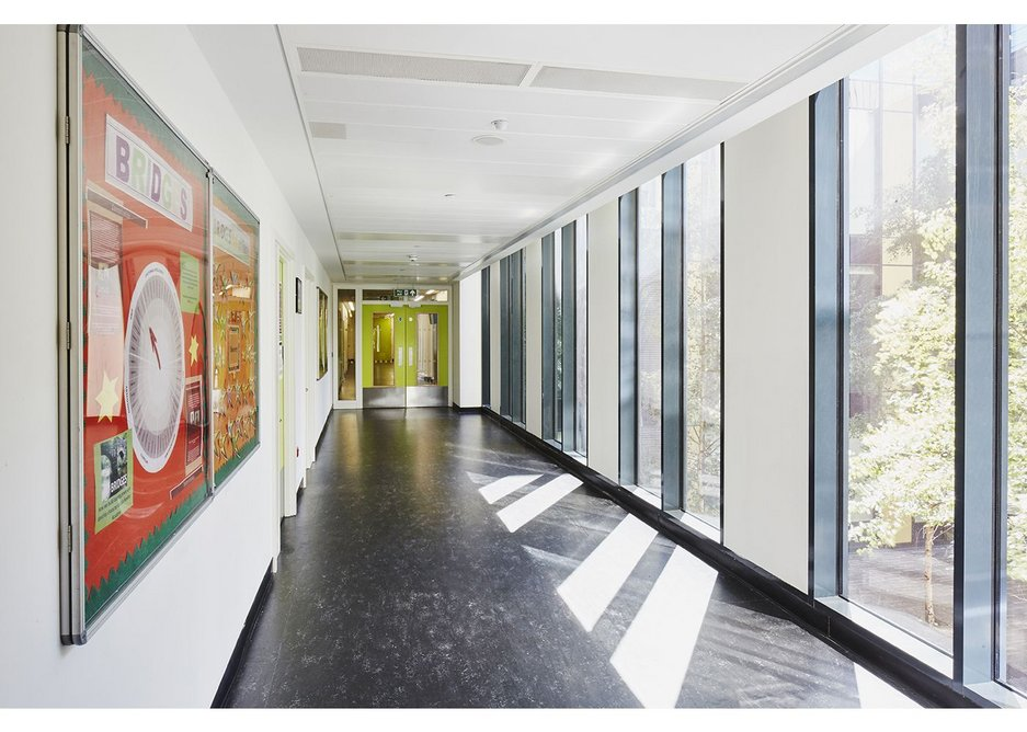 Corridor at the Isaac Newton Academy filled with natural light