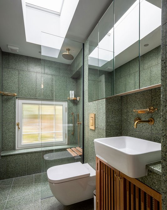 On trend but classic new terrazzo shower room with unpolished Aston Matthews brass fittings.