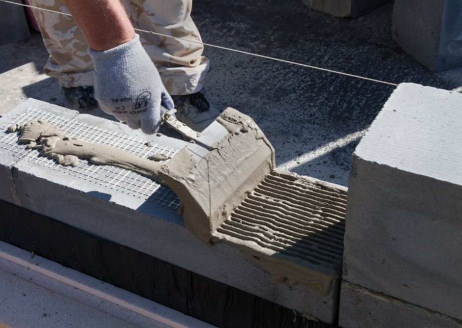Reinforcing mesh is used in areas over doors and windows and at every third layer to give the blockwork more strength.