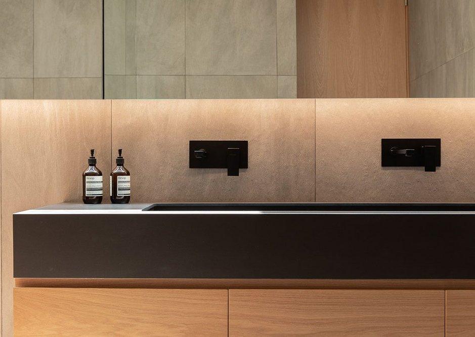 One of the en-suite bathrooms featuring Neolith Nero vanity tops.