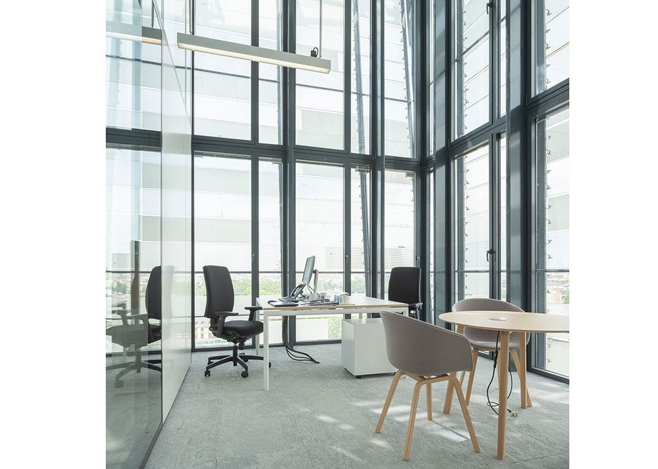 Upper level breakout spaces give broad views out over the city.