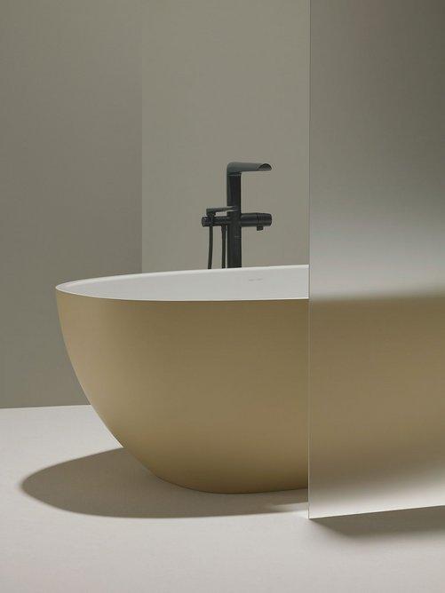 Parabola freestanding bath/shower mixer tap in Black with Victoria + Albert Barcelona bathtub.