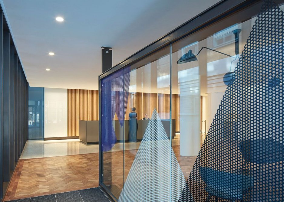 Hugh Broughton Architects has extended the existing palette of materials and augmented it with Eva Berendes' new glass art installation.