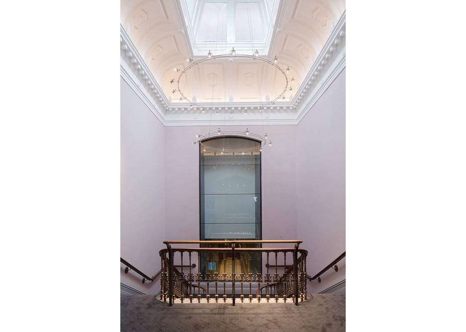 The diffuse light of the lantern staircase is now complemented with a bespoke chandelier designed by Mike Stone Lighting.