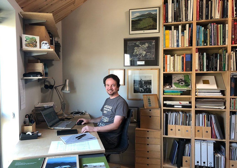 James Boon working in his home office at the award-winning Stackyard – longlisted for RIBA House of the Year.