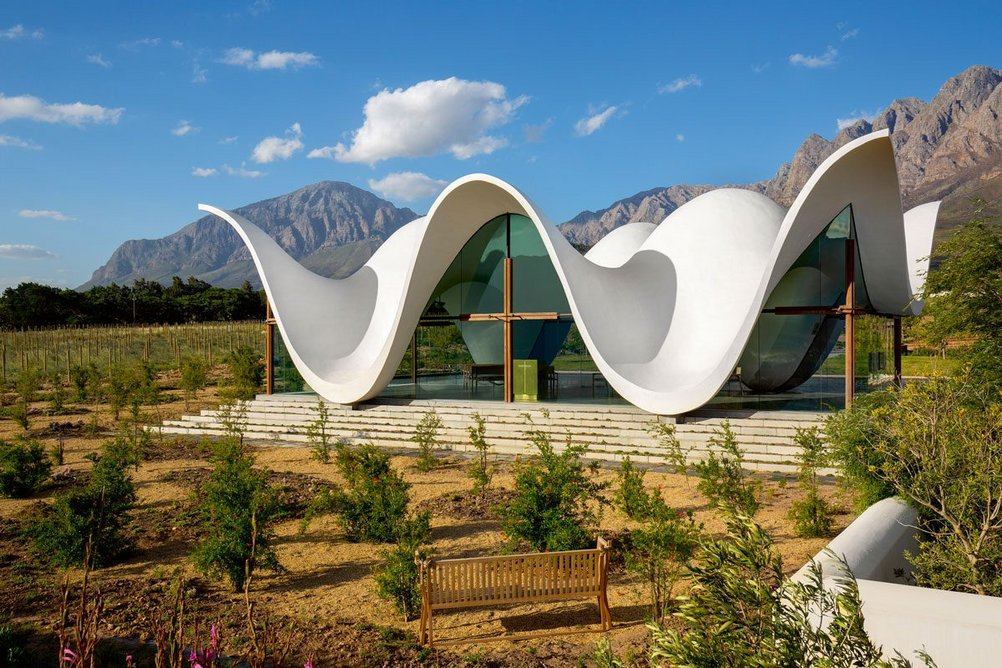 Mountains, wings in flight: the evocative undulations of the chapel's roof close up.