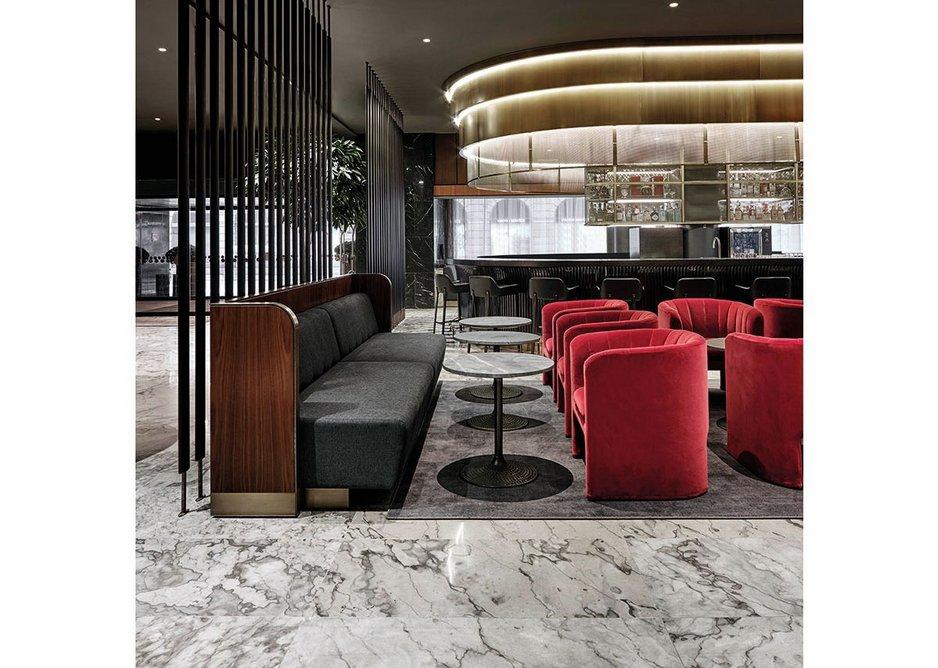 Space Copenhagen's velvet Loafer chairs complement Jacobsen's original furniture in the bar.