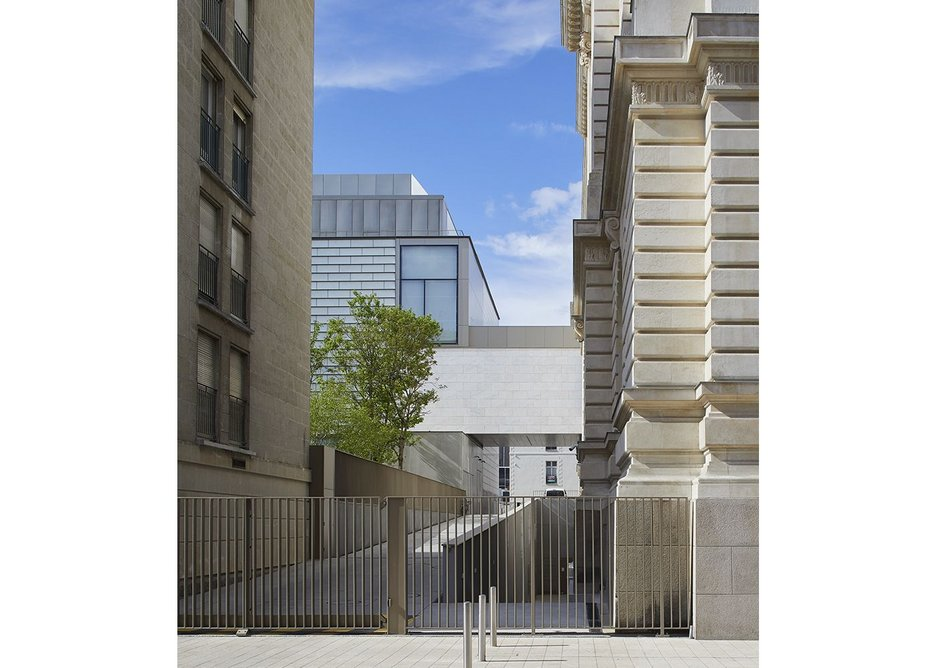 The new 'cube' containing contemporary art to the rear of the original building is accessed by the bridge at the first floor, or via passages underground. The gated road is primarily a service road, although is open during the day to pedestrians crossing the block.
