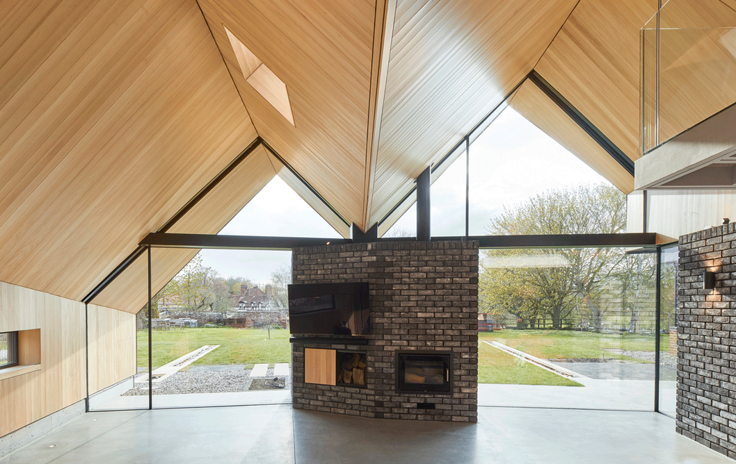 The folding roofline shapes are crafted and lined in silver fir timber and acoustic felt.