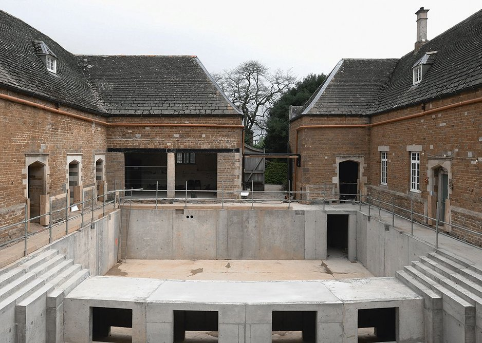 Concrete groundworks created a full sunken level for stalls and orchestra.