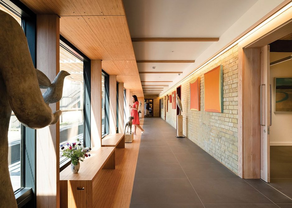 The long gallery acts as informal exhibition space and part of a flowing foyer.