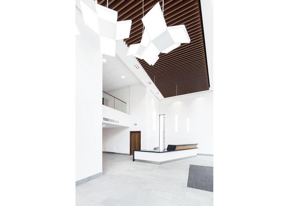 Armstrong has installed wood-effect metal baffles at BPR's refurbishment of Blake House in Uxbridge.
