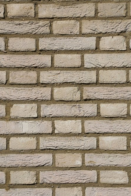 Creme brick by Vandersanden: Headers and stretchers are layered alternately in each course with headers centred on the stretchers of the course below.