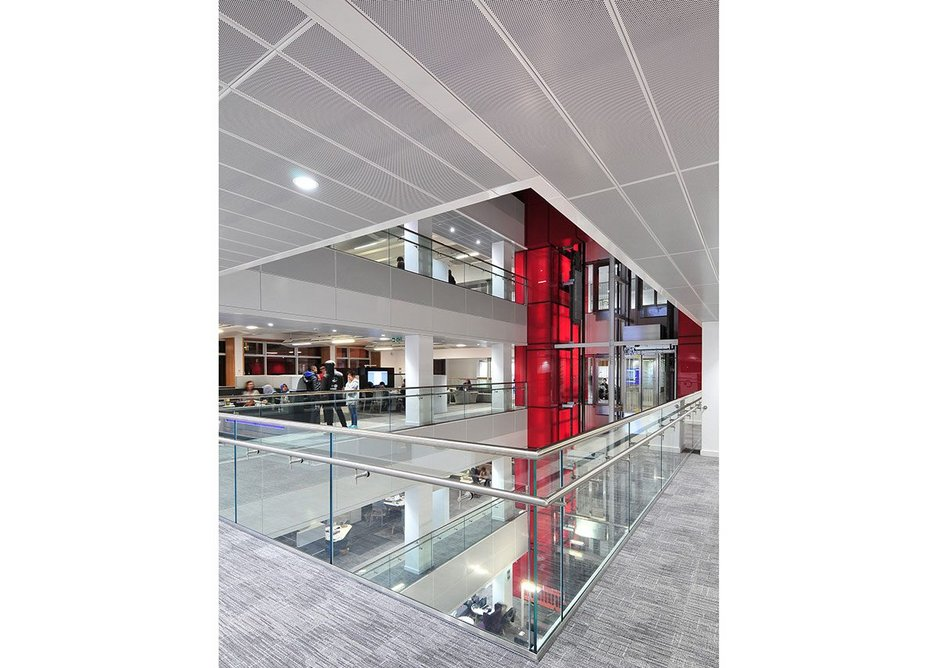 Armstrong bespoke and de-mountable T-Clip F metal perforated ceiling planks at the Alan Gilbert Learning Commons building, University of Manchester.
