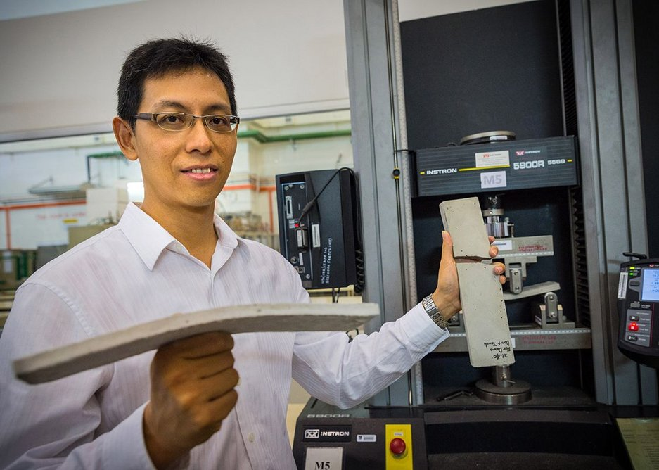 NTU Asst Prof Yang En-Hua holding the new bendable concrete in his right hand and the conventional concrete which broke on the left.