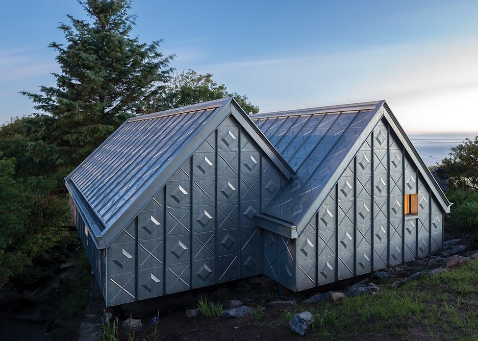 Located on a site containing the most beautiful composition of things, the studio's external zinc cladding will whiten over time.