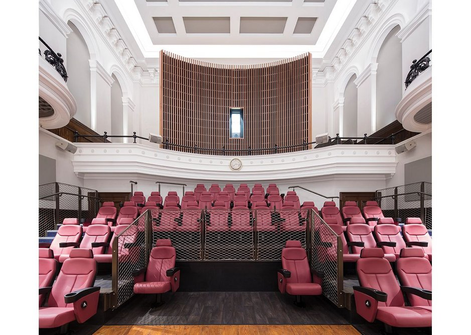 Remaining wall murals from the Old Town Hall were restored and reinserted into the conversion. Targeted downlights show them off to cinemagoers.