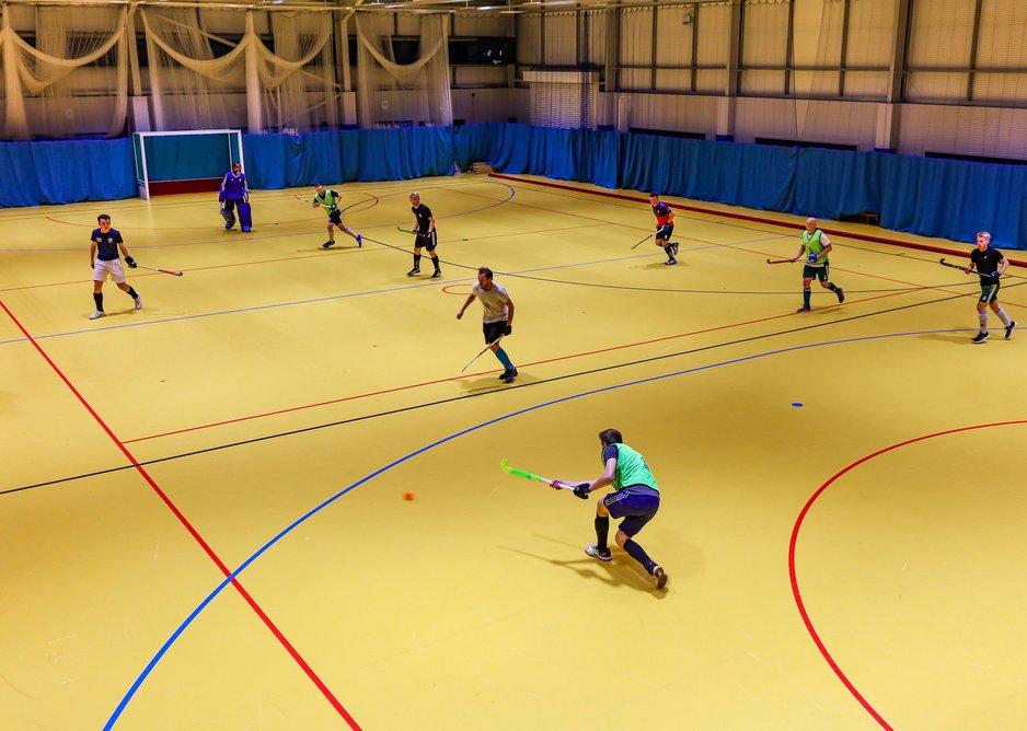 Indoor hockey being played on the Taraflex Sport M Performance floor.