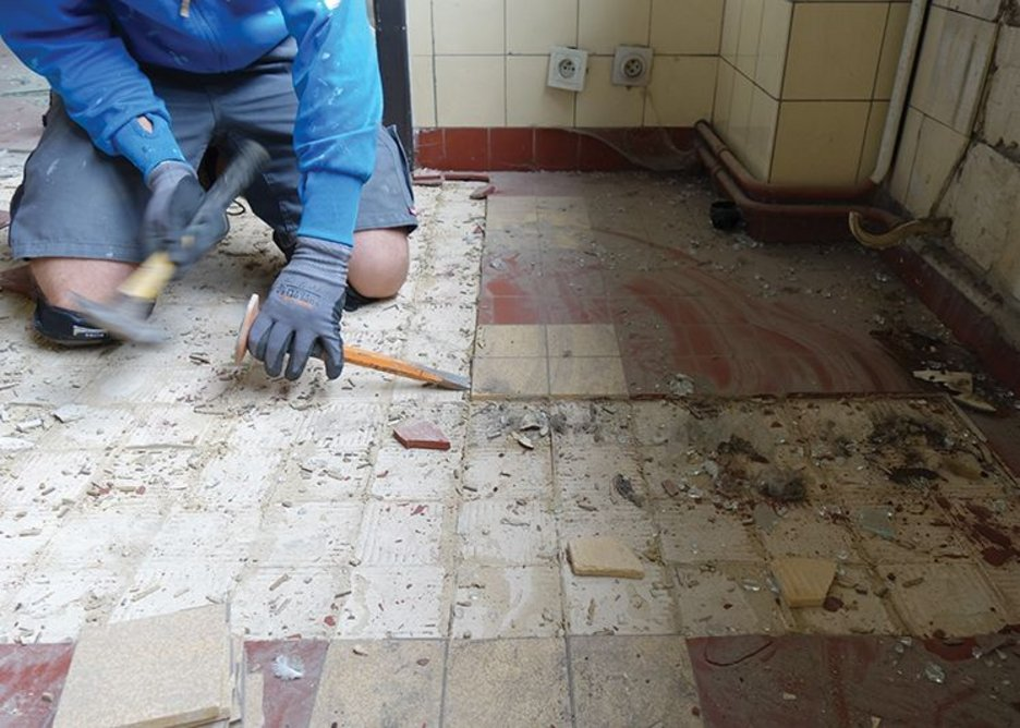 Rotor operatives set to work removing tiles that will be cleaned up, sorted and sold on.