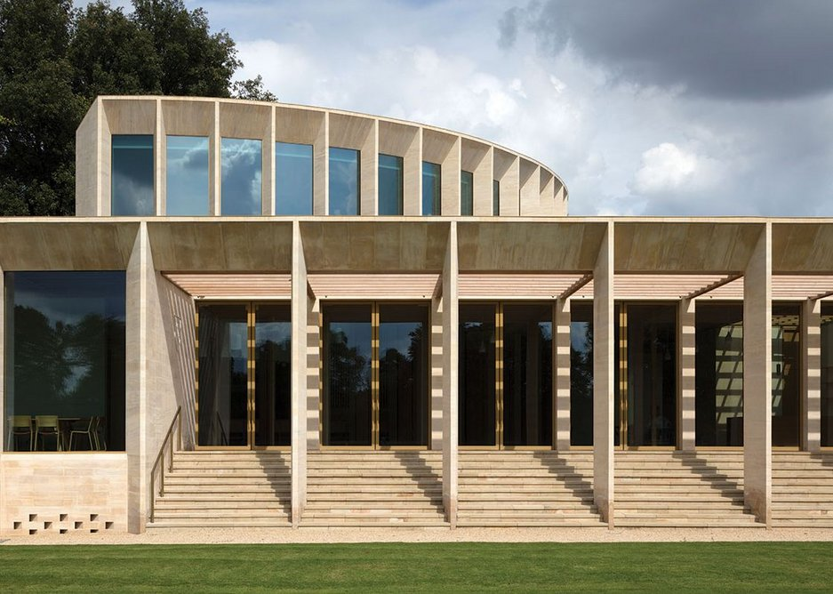 Read face on, from the cricket pitch, the openness of the facade onto the seminar rooms and loggia is very apparent.